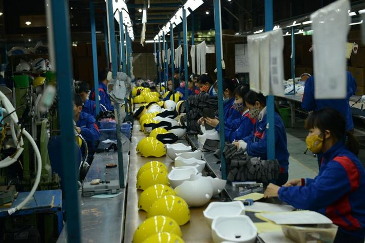 A helmet factory in Hanoi plans to switch part of its production to make medical supplies to fight Covid-19
